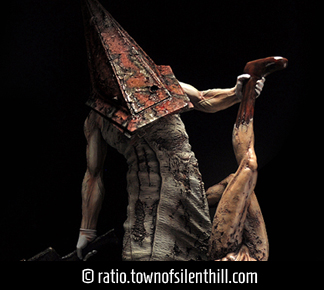 Red Pyramid Thing & Lying Figure Statue